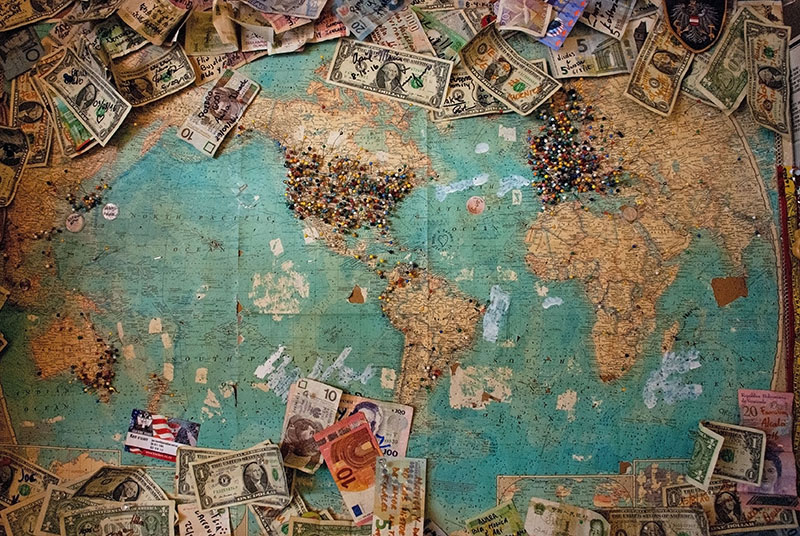 map with money in different currencies